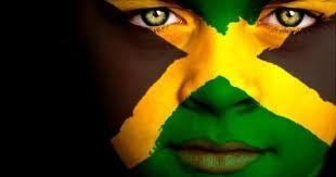Лицо ребенка, раскрашенное в цвета флага Ямайки